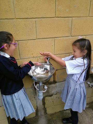 Young girls enjoying clean water