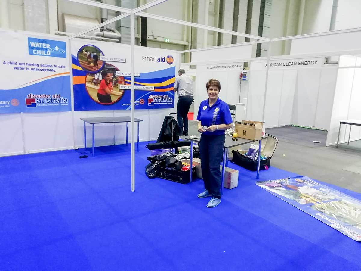 DAE Chair Irena helping to set at RI Convention Hamburg 2019